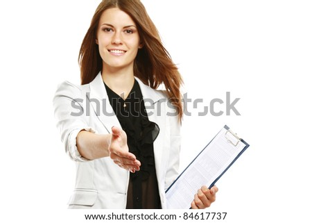 Smiling businesswoman with folder offering her hand isolated