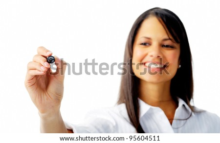Smiling businesswoman writes with a felt tip pen, isolated on white