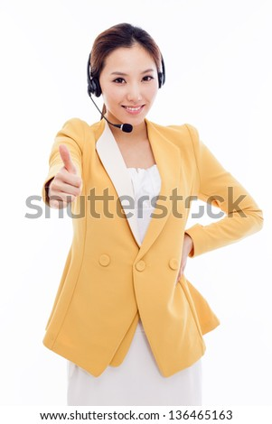 Smiling call center operator business woman and showing thumb  isolated on white background.