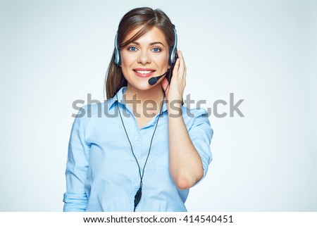 Smiling call center operator. Business woman. Headset touching.