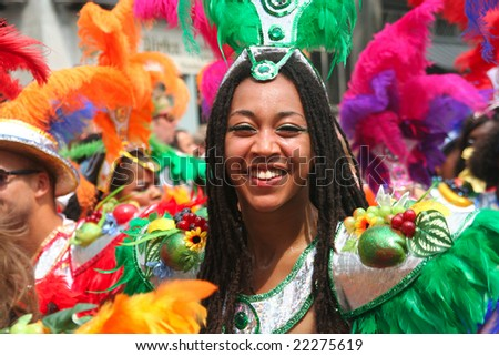 Smiling carnival dancer in the parade at the Caribbean Carnival in Rotterdam.