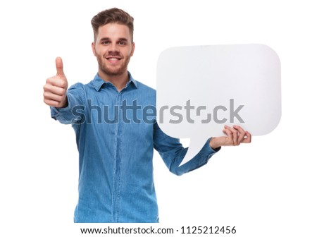 smiling casual man with speech bubble makes ok sign while standing on white background, portrait picture