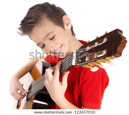 Smiling caucasian boy is playing on acoustic guitar - isolated on white background