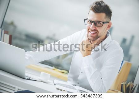 Smiling caucasian businessman at workplace. Close up portrait #543467305