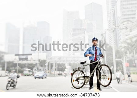 smiling caucasian businessman with his bike
