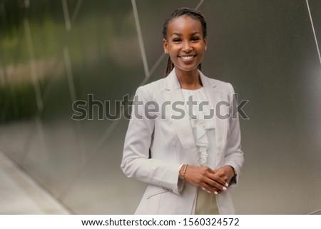 Smiling cheerful charming friendly business woman, finance advisor, representative, corporate staff
