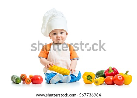 Stock Photo Smiling chef boy isolated on white background