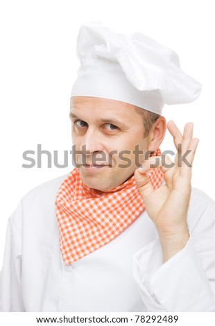 Smiling chef showing ok hand sign isolated on white