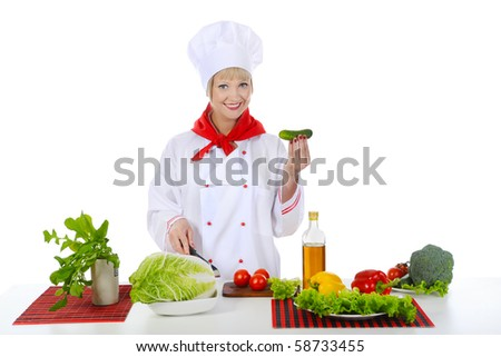 smiling chef with a cucumber. Isolated on white background