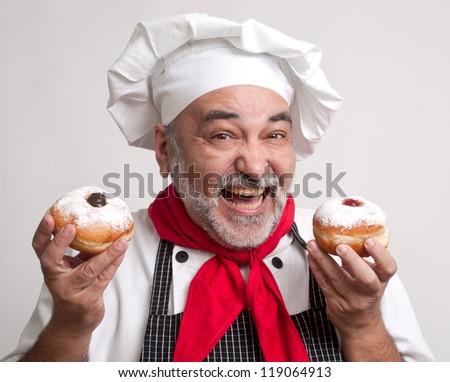 smiling chef with  hanukkah doughnut