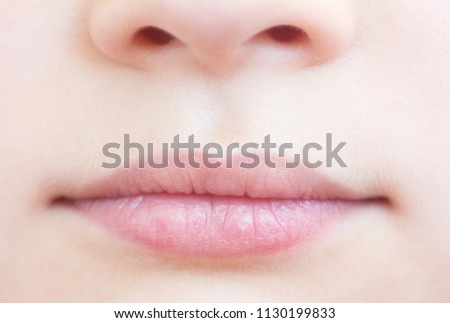 Smiling child close-up. Lips close-up.