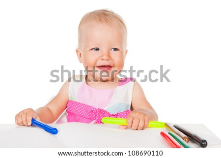 Smiling child draws with color pencils, isolated over white