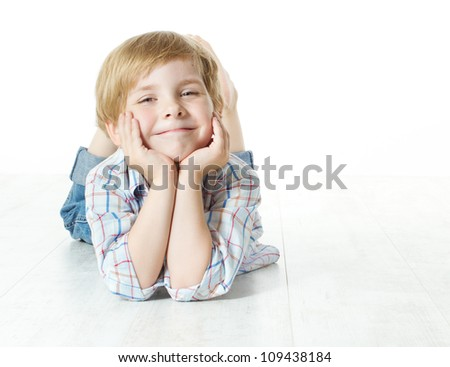 Smiling child lying down, looking at camera