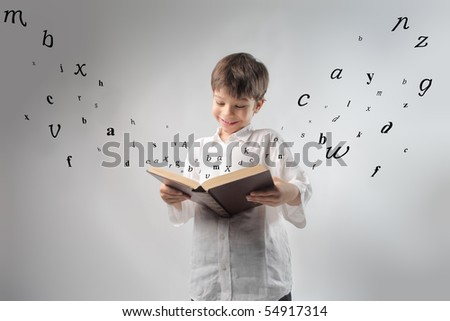 Smiling child reading a book with letters flying away from it