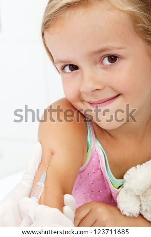 Smiling child receiving vaccine - health care concept, closeup