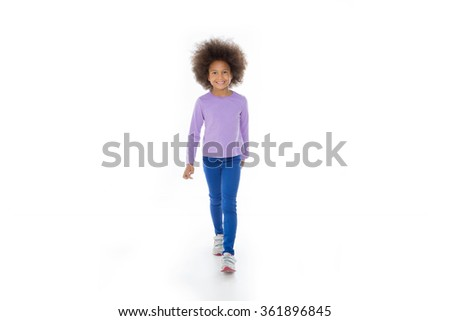 smiling child walking and looking at the camera