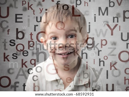 Smiling child with alphabet letters on the background
