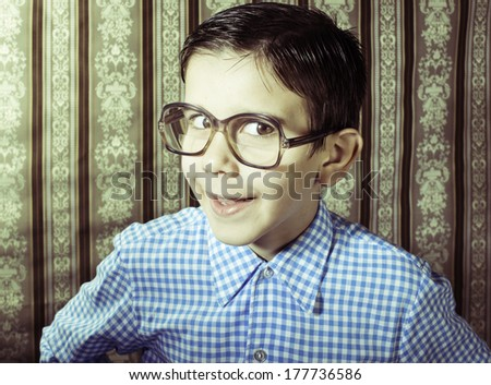 Smiling child with glasses in vintage clothes. Close up shot