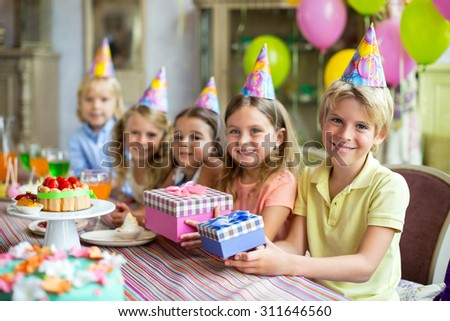Smiling children at a birthday party #311646560
