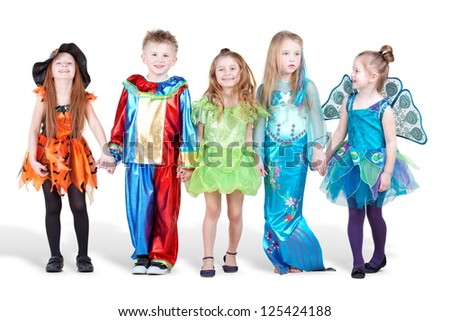 Smiling children dressed in carnival suits stand holding hands Stock photo ©