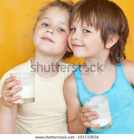 Smiling children with a glass of milk