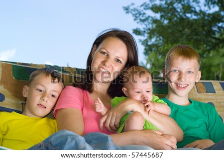 smiling children with mother
