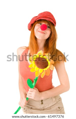 Smiling clown girl with flower