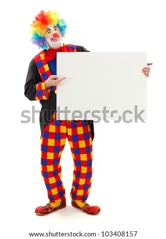 Smiling clown holding and pointing at blank white board