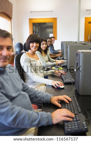 Smiling computer class in college