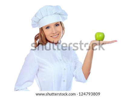 Smiling cook woman holding green apple.  Isolated over white background.