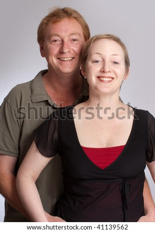 Smiling couple against a a white background
