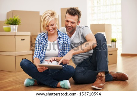 Smiling Couple Buying New Furniture For Their Home