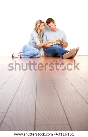 smiling couple choosing color for the  interior wall of home.