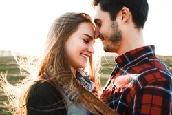 Smiling couple in love outdoors.