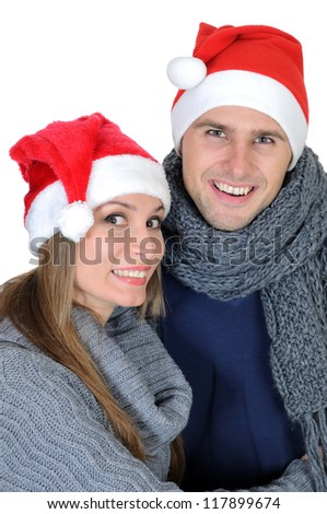 Smiling couple in Santa Claus Hats isolated on white