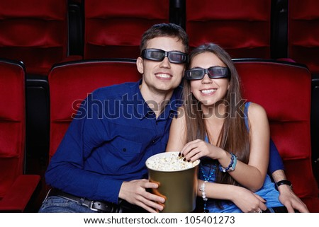 Smiling couple in the cinema