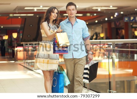 Smiling couple shopping