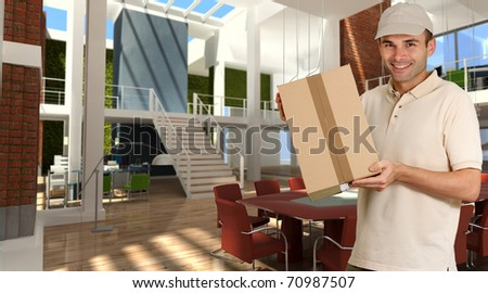 Smiling courier carrying a parcel in a modern luxurious office