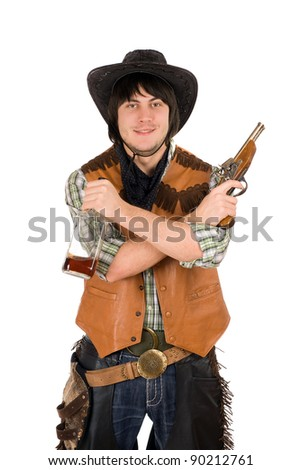 Smiling cowboy with a bottle and gun in hands