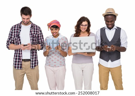Smiling coworkers standing and using technology on white background #252008017