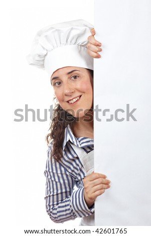 Smiling curious cook woman behind the white card isolated on white background