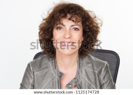 smiling curly girl at desk smile and happy woman #1125174728