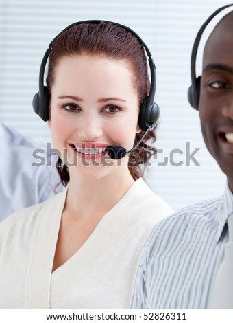 Smiling customer service representatives with headset on standing in a line