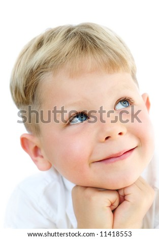 Smiling, cute five year old boy studio portrait on white background