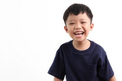 Smiling cute little Asian boy portrait, isolated on white background.
