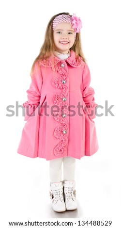 Smiling cute little girl in coat isolated over white