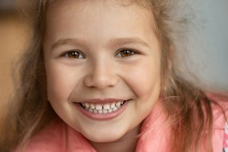 Smiling cute little girl portrait. This file is cleaned and retouched.