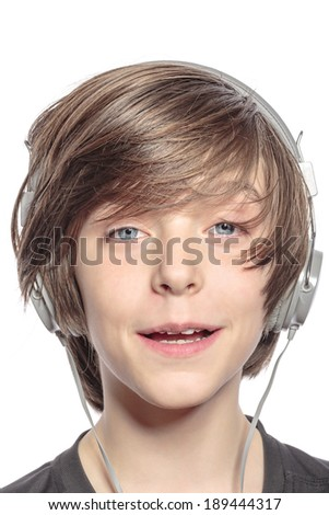 smiling cute teenager boy with headphones, isolated on white.