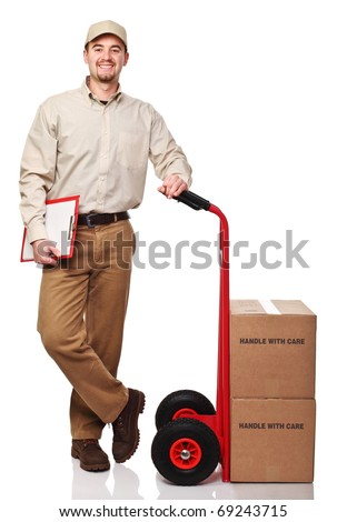 smiling delivery man with red handtruck isolated on white