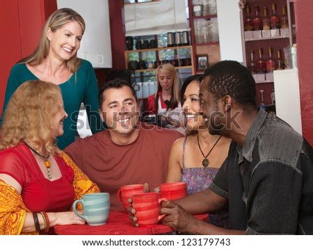 Smiling diverse group of mature adults in cafe